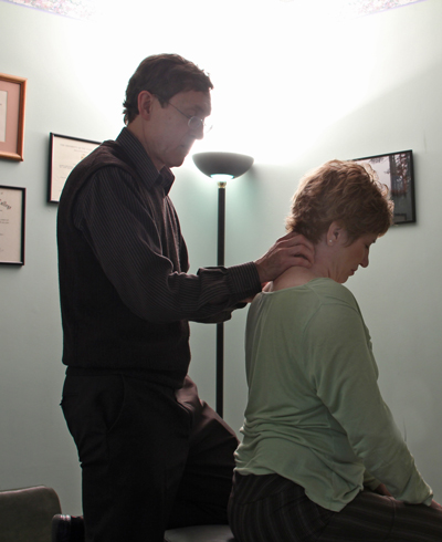 Dr Maryott Treating a patient using Chiropractic manipulation